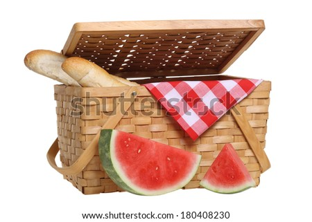 Picnic basket with watermelon and bread, cutout on white background - stock photo