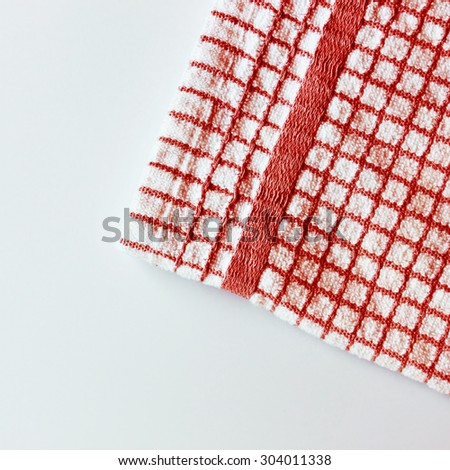 Picnic checkered towel on white table - stock photo