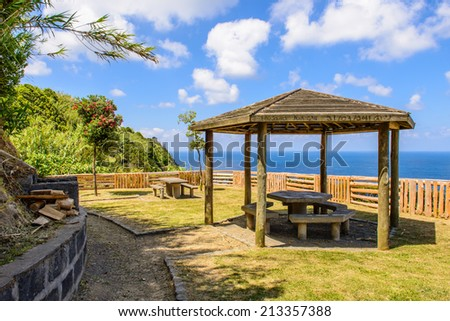 Picnic hut with table and view on the Atlantic Ocean, Azores, Portugal, Europe - stock photo