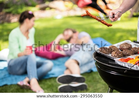 Picnic in the garden at sunny day - stock photo