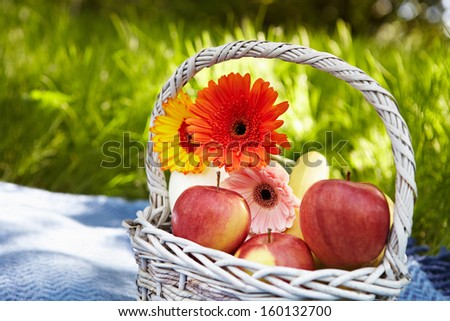 Picnic in the garden. Flowers and fruits.
