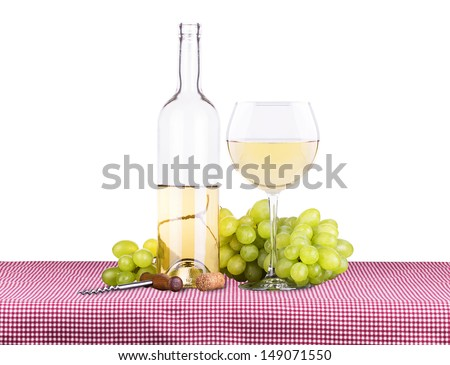 picnic lunch on a red and white gingham tablecloth including a white wine and grapes