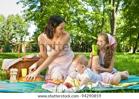 Picnic - mother with children - stock photo