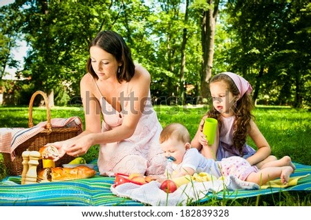 Picnic - mother with children in park - stock photo