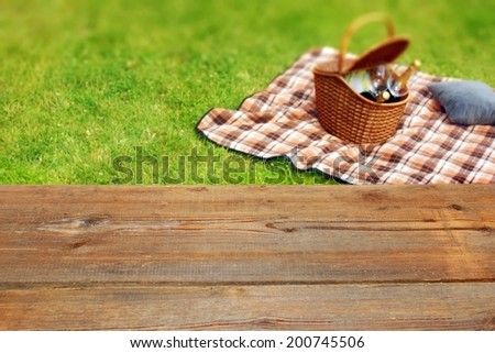 Picnic Table Background picnic table blanket basket grass background stock photo 200745506
