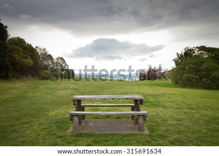 picnic table in a grassy reserve above an ocean beach, sponge Bay, Gisborne, East Coast, North Island, New Zealand