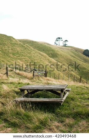 picnic table in nature - stock photo