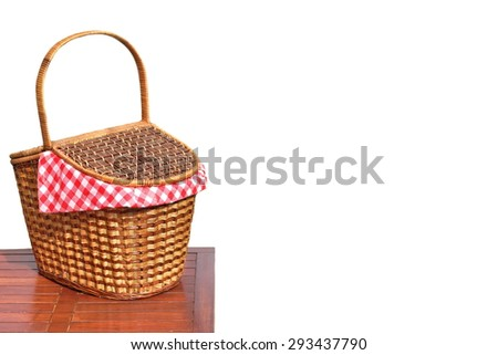 Picnic Wicker Basket Or Hamper On The Outdoor Wood Table Isolated On White Background Close-up - stock photo