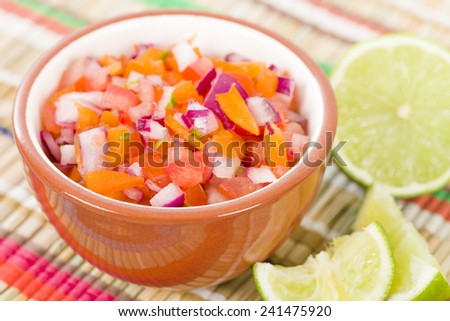 Pico de Gallo - Mexican salad in a bowl.  - stock photo