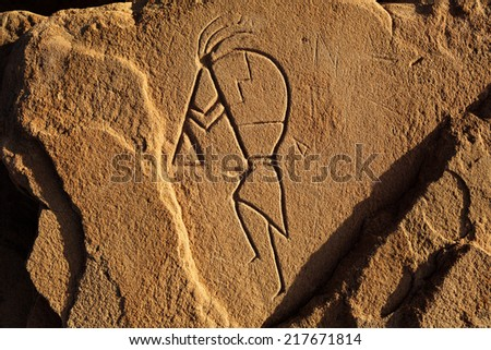 pictograph on rock face at the canyon Chelly - stock photo
