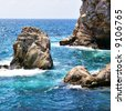 pictorial blue Adriatic sea with rocks - stock photo