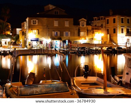 Pictorial harbour at night - stock photo