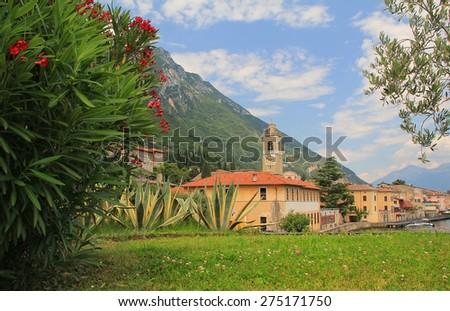 pictorial village gargnano, lago di garda, with oleander and church - stock photo