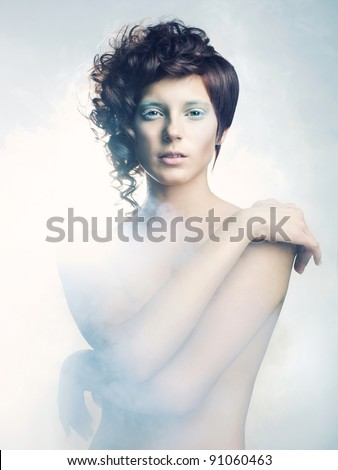 Picture a beautiful angelic woman in the fog - stock photo