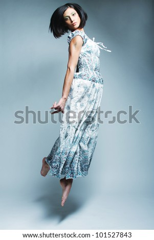 Picture a beautiful fairy flying girl in blue  dress