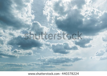 Picture airplane with plane trail at white clouds - stock photo