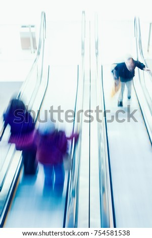 Picture blurred abstract background of people use escalator