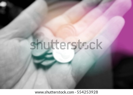 Picture blurred  for background abstract and can be illustration to article of coins in hands