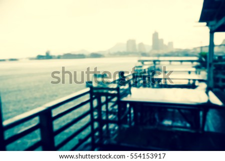 Picture blurred  for background abstract and can be illustration to article of table in restaurant near sea