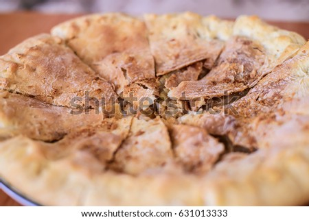 Picture closeup sliced into several parts delicious apple pie