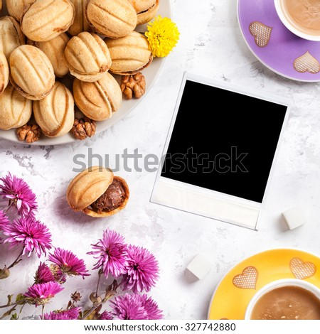 Picture frame around coffee and sweet homemade nuts on white marble background   - stock photo