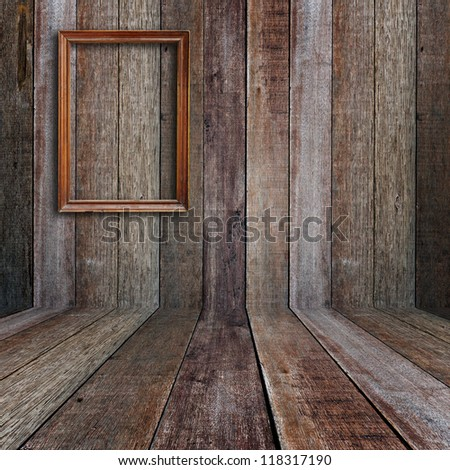 Picture frame in vintage wood room. - stock photo