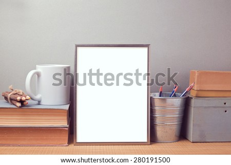 Picture frame mock up template with books and desk objects - stock photo