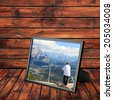 Picture frame with photo of Rocky Mountains  Bow river landscape and man looking down from Sulfur mountain at (Banff National Park. Alberta.Canada) on the wooden panel background.Collage of my photos  - stock photo