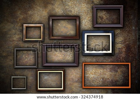 picture frames on abstract rusty wall ready for your design