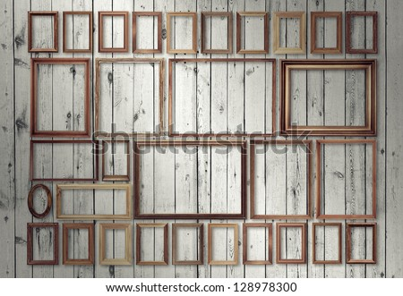 picture frames set on wooden wall