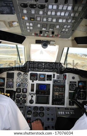 Picture from the cockpit; pilots preparing the plane to land; - stock photo
