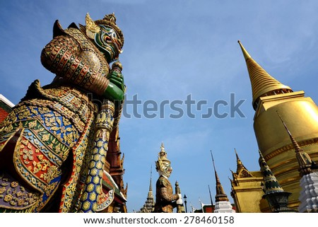 Picture from Wat Phra Kaew famous place and landmark of Thailand, Big Giant at the Entrance of Wat Phra Kaew Temple Grand Royal Palace in Bangkok province - stock photo