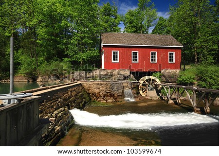 Picture, general view of old (historical building) Living Museum, Sawmill on Beaverdams Creek Ontario and small pond with pond wall and Water Wheel which was powered the water sawmill.