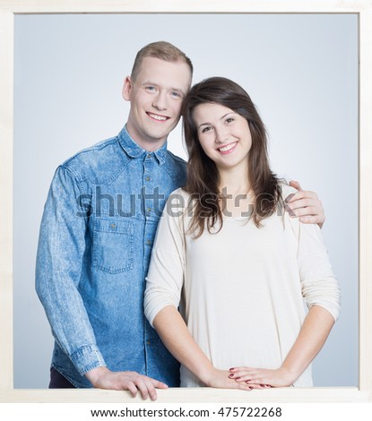 Picture in a white frame of a young, happy couple
