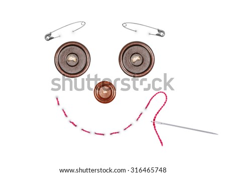 picture made with buttons, pins , needle and thread - stock photo