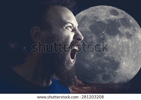 Picture of a bearded man screaming at the moon in moonlight. - stock photo