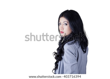 Picture of a beautiful Asian businesswoman with long hair, standing in the studio. Isolated on white background