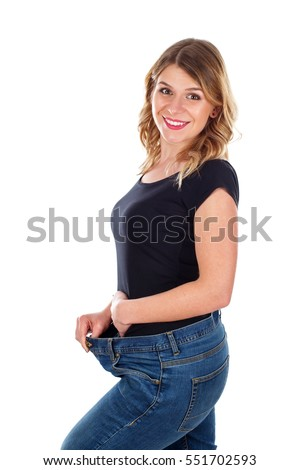 Picture of a beautiful woman showing her huge weightloss - isolated background