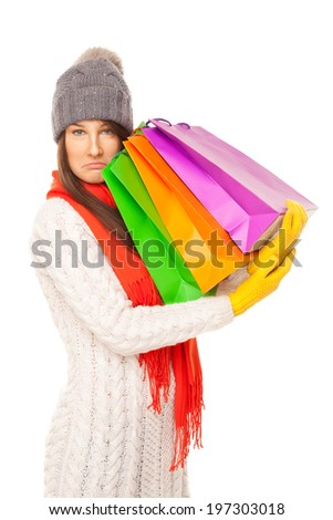 Picture of a beautiful woman with shopping bags isolated