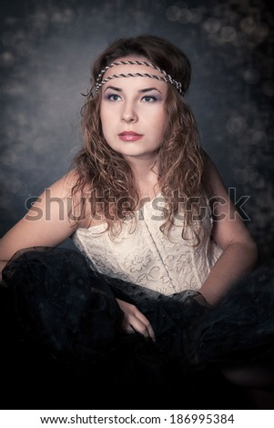 Picture of a beautiful young blonde woman. Vintage style. Fashion photo