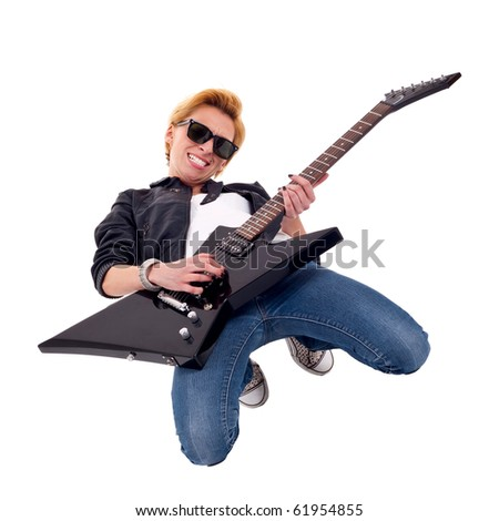 picture of a blond passionate woman guitarist playing on her knees - stock photo