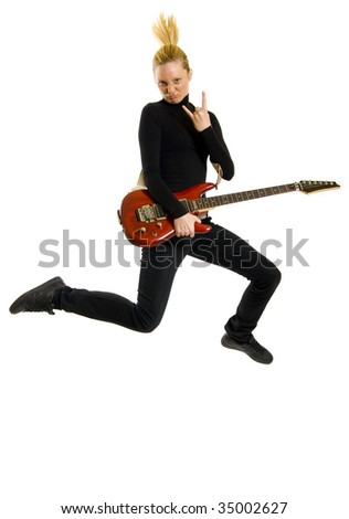 picture of a blond woman guitarist jumping and making a rock sign
