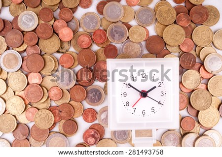 Picture of a Business Money Concept Idea, Clock and Coins