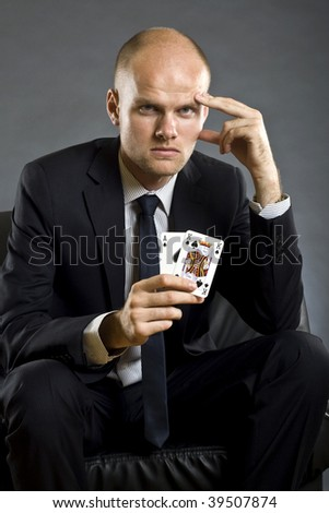picture of a businessman holding a poker hand - ace king of spades