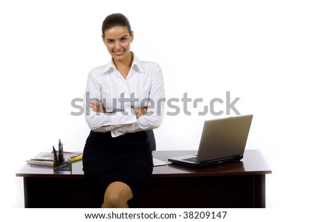 picture of a businesswoman  against office desk