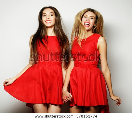 Picture of a charming young girls in red dress  - stock photo