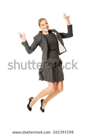 Picture of a cheerful jumping businesswoman - stock photo