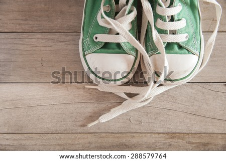 Picture of a child shoe on a wooden floor - stock photo