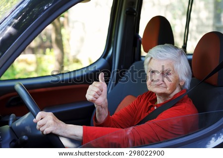 Picture of a confident senior woman driving a car - stock photo