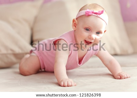 Picture of a crawling baby in diaper at home - stock photo